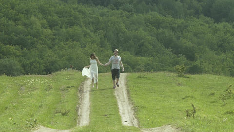 Couple Running In The Field Footage