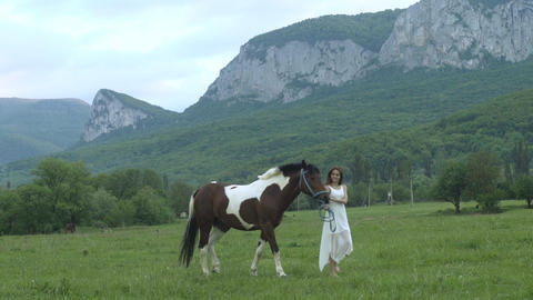 Pretty Young Woman With A Horse Footage
