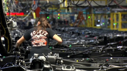 WORKER AT GENERAL MOTORS CAR FACTORY ASSEMBLY LINE Footage