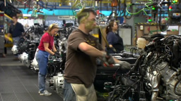 ASSEMBLY LINE WORKERS AT GENERAL MOTORS CAR FACTORY Footage