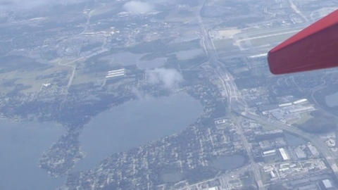Looking out an airplane window in flight aerial sky view Footage
