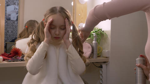 Young girl photo model while spraying curly hairstyle in dressing room Footage