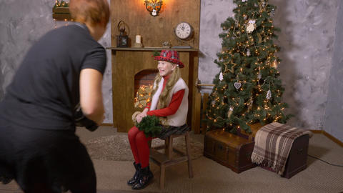 Girl teenager posing in photo studio with Christmas... Stock Video Footage
