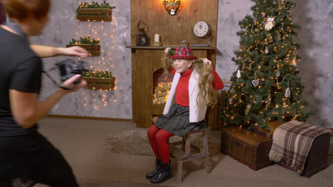 Girl teenager posing in photo studio with Christmas interior at photo session Footage