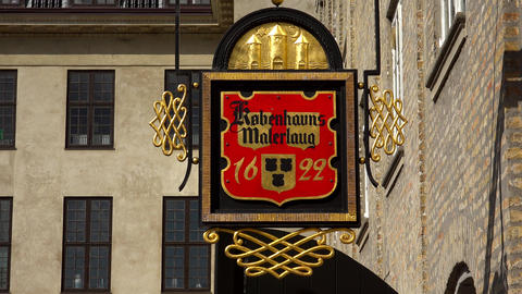 Vintage emblem on the wall of an old house. Copenhagen. Denmark. 4K Live Action
