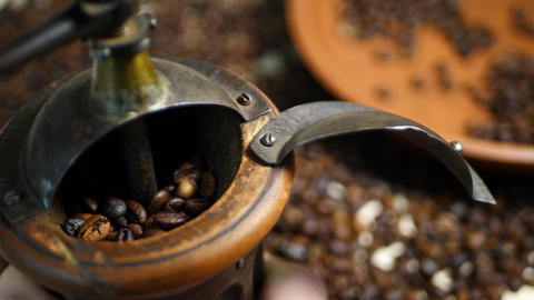 Antique coffee grinder with coffee beans in blurred background Footage