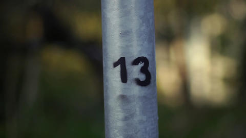 The number 13 is drawn on the pipe in black paint Footage