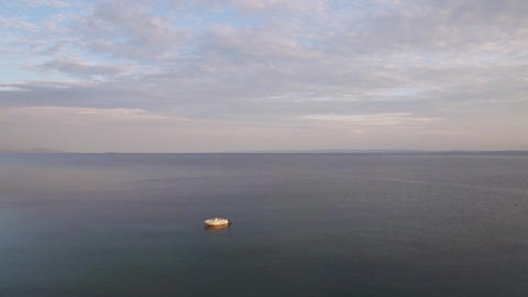 Flying over quiet sea with single boat Footage