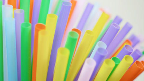 Top view of colorful straw on the rotation table Live Action