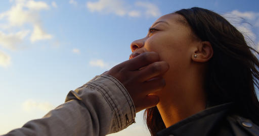 Close-up of couple embracing on a sunny day 4k Live Action