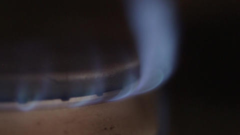 Natural gas flame from kitchen stove burner - Energy and power concept ビデオ