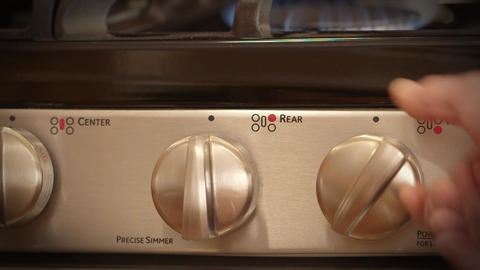 Kitchen stove temperature control knob Footage