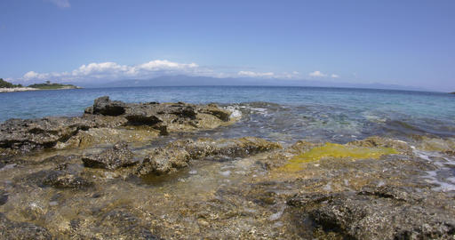 Blue Waves And Transparent Of The Ionian Sea That Burst The Rocky Shore Of An Is stock footage