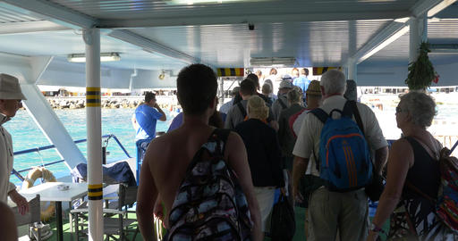 Tourists and citizens descend on board a cruise ship that docked in port 72 Footage