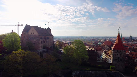 Aerial German Bavaria rising city with an old castle in the foreground at beauti Footage