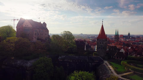Aerial German Bavaria city with an old castle in the foreground at beautiful sun Footage