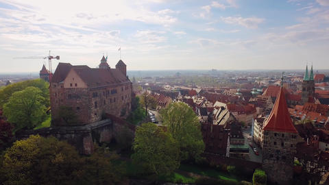 Aerial German Bavaria city with an old castle in the foreground Footage