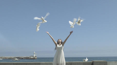 Happy Woman Releasing A Pigeons Footage