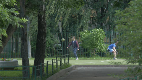 Teens Playing In The Park With Ball Footage