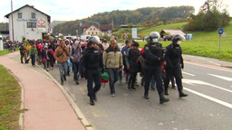 RIOT POLICE LEADING COLUMN OF MIGRANTS EU REFUGEES stock footage