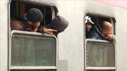 MIGRANTS LOOKING OUT OF TRAIN WINDOWS EU REFUGEES Footage