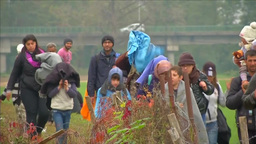 WOMAN WITH SMALL CHILDREN WALKING TOWARDS REFUGEE CAMP EU MIGRANTS Footage