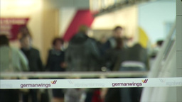 PEOPLE AT CHECK IN DESKS AT AIRPORT GERMANWINGS QUEUE DIVIDER stock footage