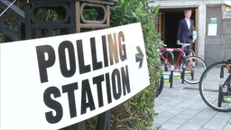 PEOPLE LEAVING POLLING STATION AFTER VOTING IN ELECTION Footage