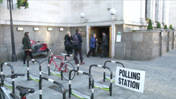 PEOPLE ENTERING POLLING STATION TO VOTE FOR ELECTION Footage