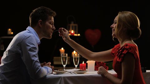 Couple having romantic dinner in high-quality restaurant, evening for two, date Live Action