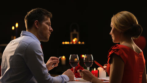 Male and lady having dinner in restaurant tasting red wine, couple on blind date Footage