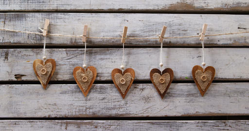 Heart shaped decorations pinned on a rope 4k Live Action