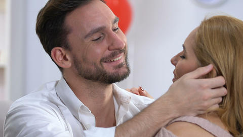 Closeup of man tenderly embracing woman, loving trust relationship, happy family Live Action