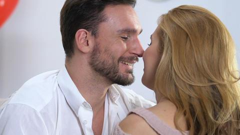 Handsome man caressing his beloved woman kissing on shoulder, affection romance Live Action