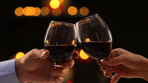 Close-up male and female hands clinking glasses with wine, fest celebration Footage