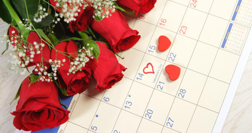 Bouquet of red roses on the calendar showing 14th February 4k Live Action