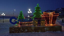 Night view illuminated festive composition inscription in Russian Happy New Year Footage