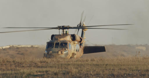 Military BlackHawk helicopter during a rescue mission in a base Live Action