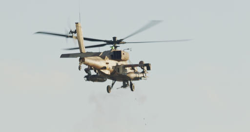 AH-64D Apache Longbow military helicopter attacking targets with canon Live Action