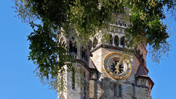 Clock of Kaiser Wilhelm Memorial Church Behind A Tree In Berlin, Germany 영상물