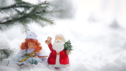 Christmas decorations in nature with toys of Santa Claus and snow maiden Footage