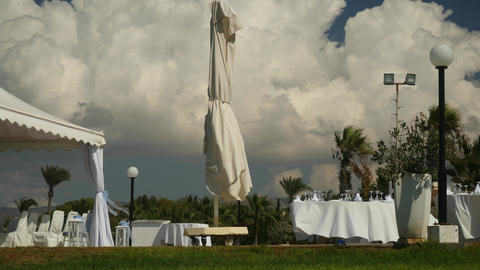 Cloudy windy landscape view with open-air preparing buffet in white colours on Footage