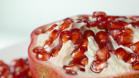Pomegranate and grains on a rotating table Footage