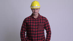 Handsome bearded man construction worker against white background Archivo