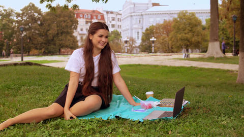 woman chatting online outdoors Live Action