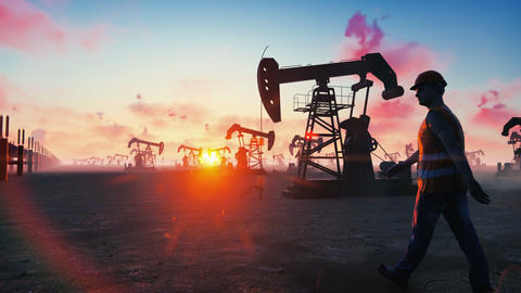 Oil worker inspects oil pumps at sunrise on the background of cloudless Animation