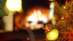 Pick up a gift. Christmas gift box. Christmas three on glow fireplace bokeh 영상물