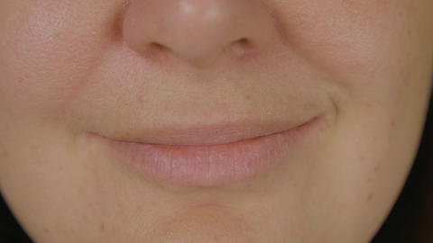Female face, mouth and smiling lips close up. Smiling female lips and mouth Live Action