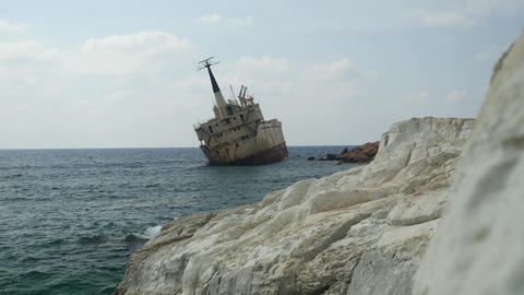 Grounded ship off the coast of Cyprus Broken ship aground off the rocky seashore Live Action