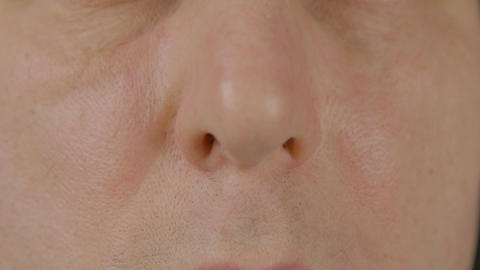 Close up male nose front view. Plastic surgery. Respiratory and otolaryngology Live Action